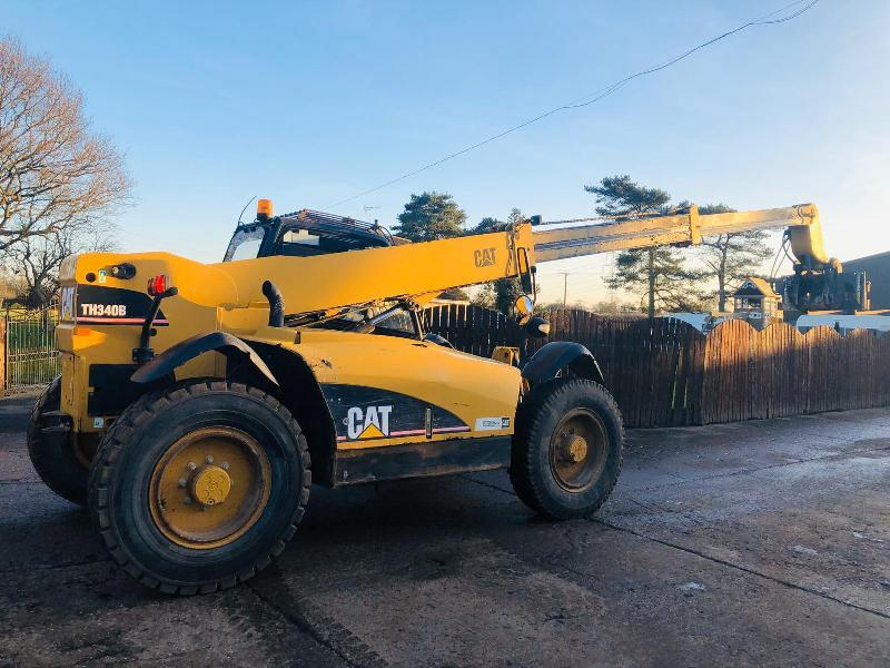 CAT TH340B TELEHANDLER C/W BUCK, TINES & ROTATING STRIMACH HEAD STOCK  IN LOLA TEST
