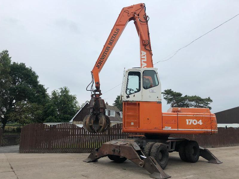 ATLAS 1704 WHEELED SCRAP HANDLER HIGH RISED CABIN C/W 5 TINE ROTATING GRAB ( SEE VIDEO )