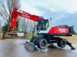 O&K MH6.5 WHEELED EXCAVATOR C/W BLADE & QUICK HITCH